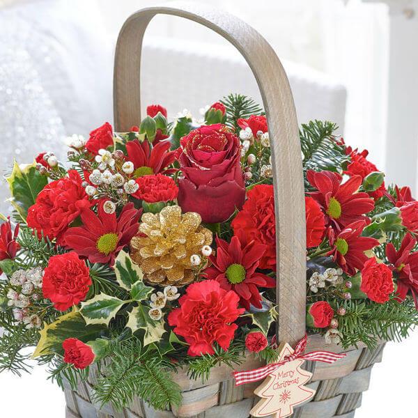 festive charm basket of flowers