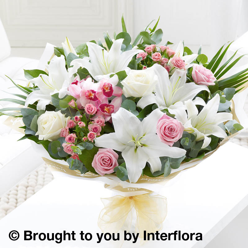 bouquet with orchids,roses and lilies
