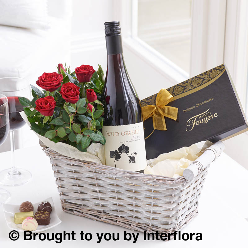 gift basket with wine,chocolates and plant