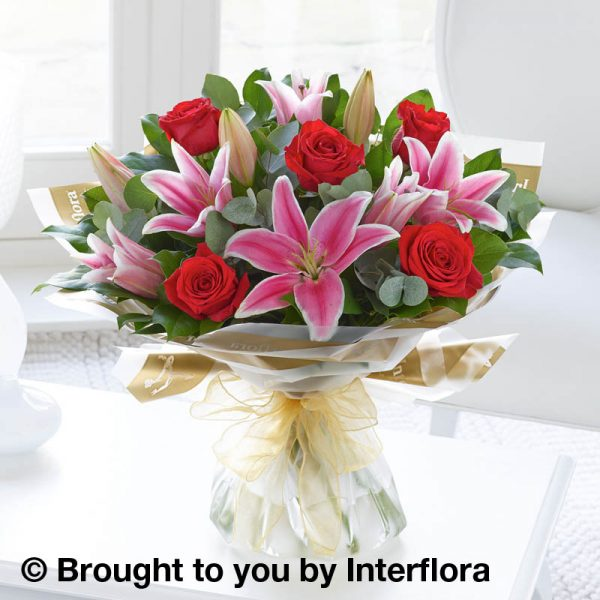pink lily and red rose bouquet