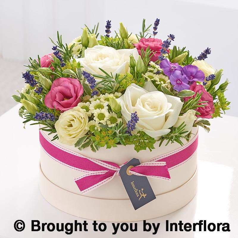 hatbox arrangement of summer flowers