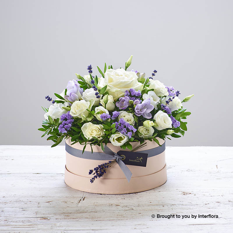 hatbox arrangement of flowers