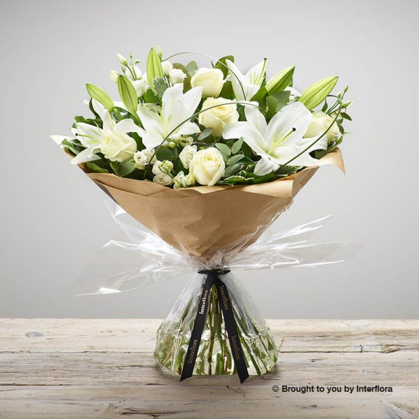 white lilies,lisianthus and roses