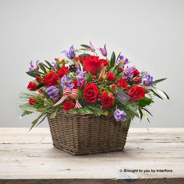 cosy crimson basket of flowers