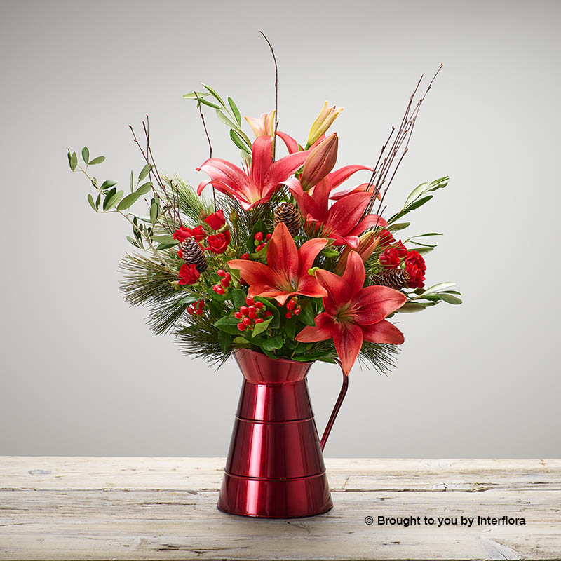 Jug of Christmas flowers